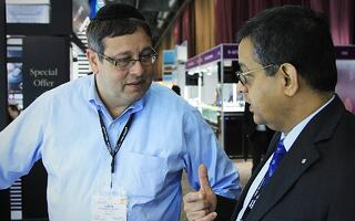 Owner & Founder of Facets Singapore, Suresh Hathiramani in discussion with a New York diamond dealer | Facets Singapore