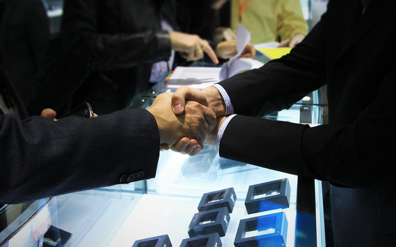 """A handshake and """"Mazel Und Broche."""" A deal is done. 