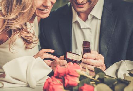 Man proposing with a diamond ring
