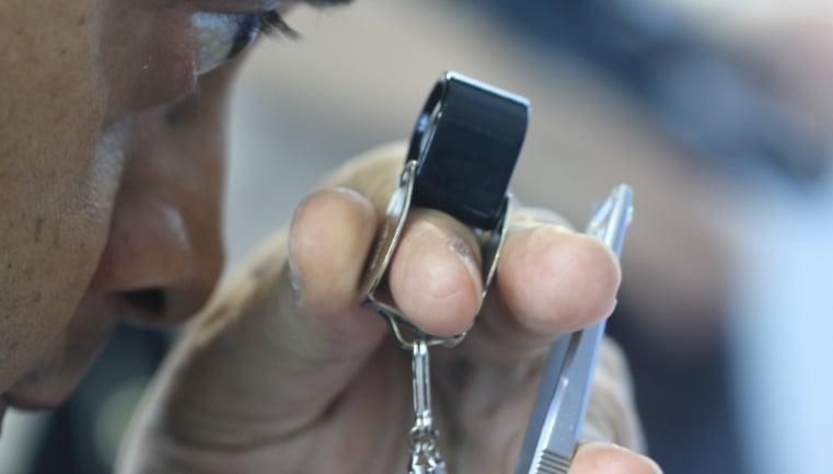 Suresh Hathiramani Inspecting a diamond   Facets Singapore