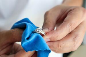Jeweller cleaning ring with polishing cloth | Facets Singapore