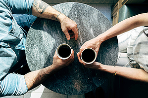 Discussing diamond ring designs over a cup of coffee