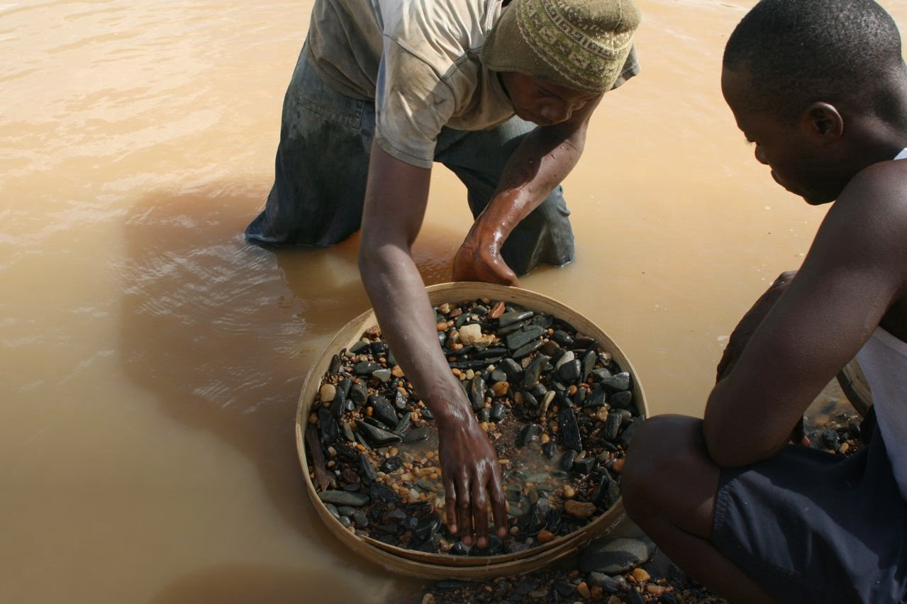 Diamond panning along a river bed in Africa | Facets Singapore